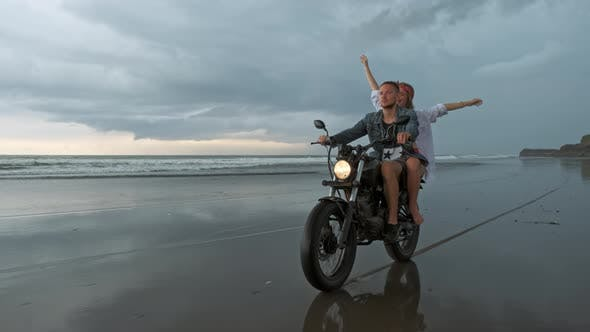 Thumbnail for Young Beautiful Couple Hipsters Riding Retro Motorcycle on the Beach, Outdoor Portrait, Riding Guy