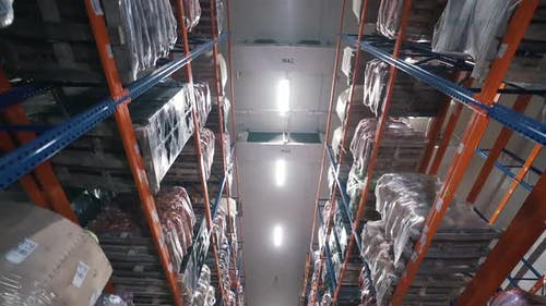 Shelves with Goods in a Logistics Center