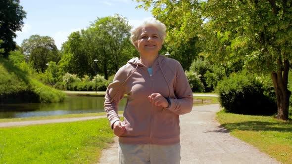 Cover Image for Senior Woman Running Along Summer Park