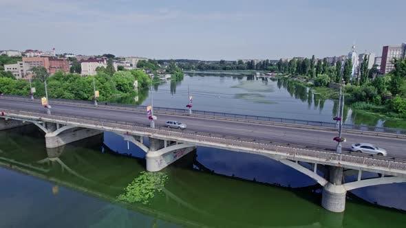 Calm River Along Europian Small Town