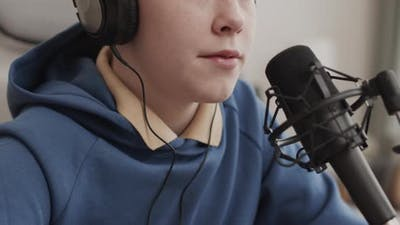 Cropped Boy Recording Song at Home