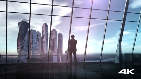 Thumbnail for Businessman In Office Overlooking A Business Center 4K