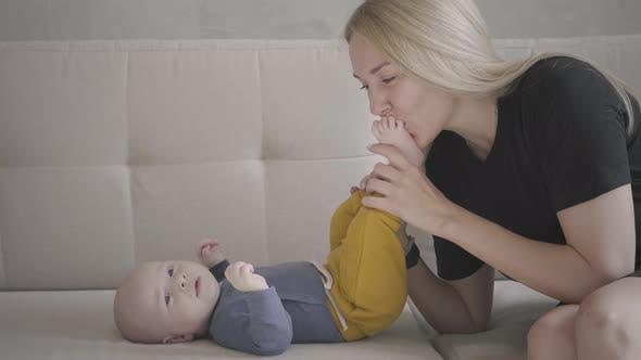 Mom Kissing Baby Feet