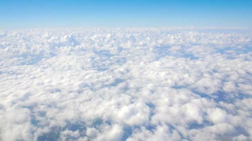 Accumulation of clouds under moving airplane, cloudscape, fulfilling dreams