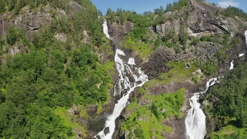 Drone Rising Up Mountainside With Cascading Water