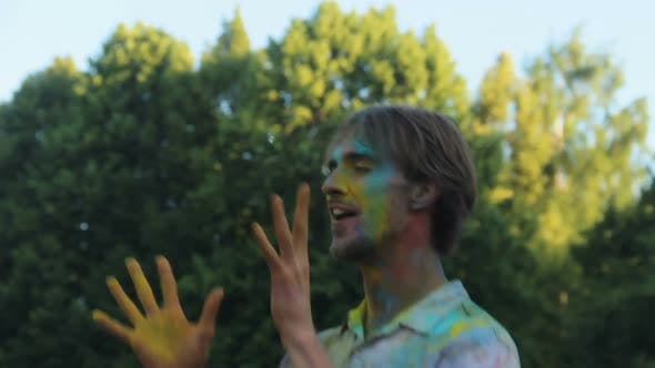 Thumbnail for Young Man Covered in Colored Paint Dancing and Having Fun at Holi Festival