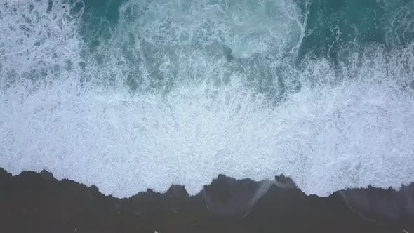 Thumbnail for Aerial Top View Turquoise Waves Break on Empty Beach, Ocean Waves Reaching Shore From Above