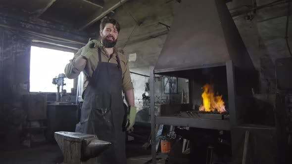 Thumbnail for Handsome Blacksmith Standing in Smithy