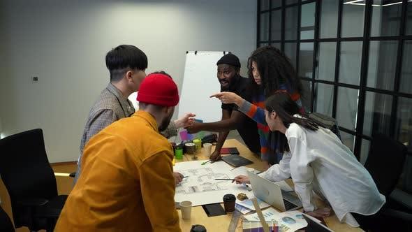 Inspired Multiethnic Design Team During Work