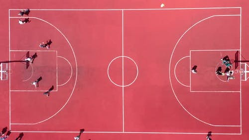 Aerial View of Young Athletes Playing Street Basketball on an Open Summer Playground