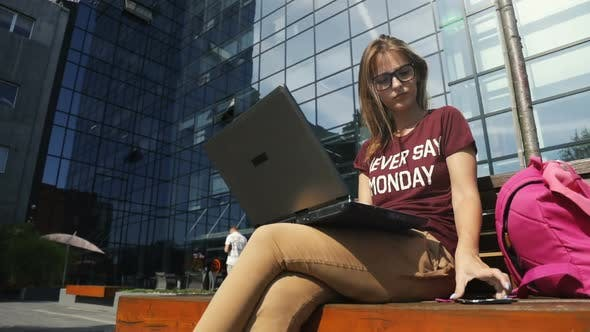 Thumbnail for Woman Uses Laptop Outdoors