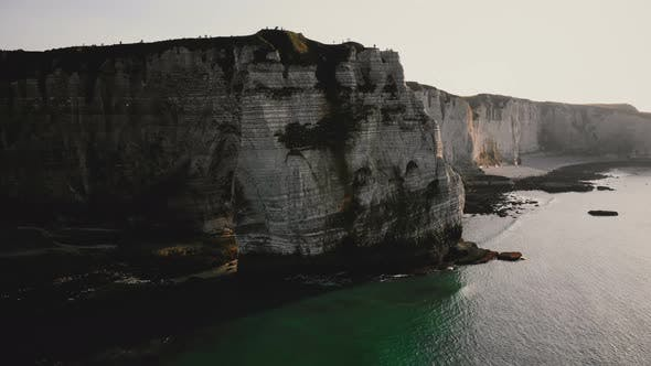 Thumbnail for Amazing Panning Drone Shot of Epic Natural Eroded Alabaster Rock Arch and Famous White Sea Cliffs on