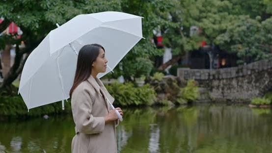 Thumbnail for Woman Bring of Umbrella in The Park