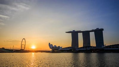 night to day Time-lapse of urban cityscape of Singapore with sunrise