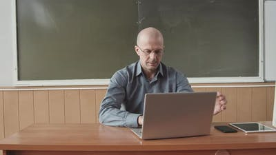 Portrait of Male University Professor with Laptop