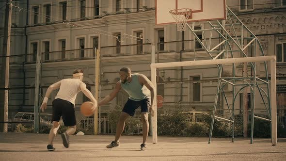 Thumbnail for White and Black Men Playing Basketball