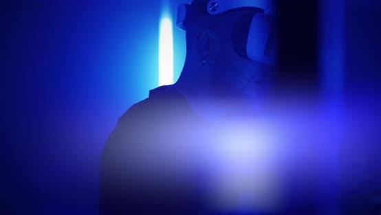 Man Exploring Virtual Reality Under Blue Illumination