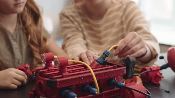 Two People Constructing Robot