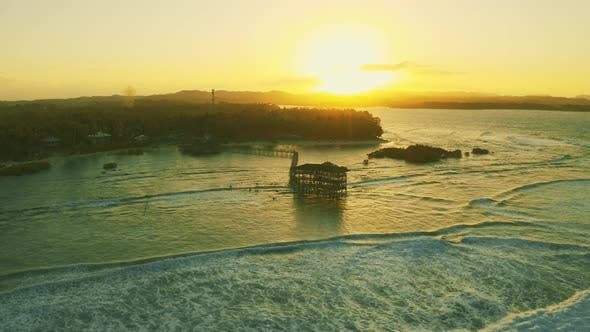 Cover Image for Big Waves Are Coming and Beautiful Sunset Landscape at the Wooden Bridge on Cloud 9 Beach, Siargao