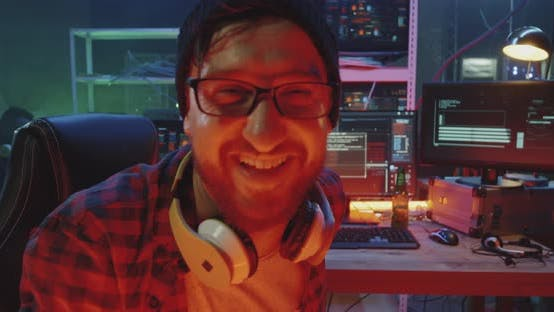 Thumbnail for Hacker Laughing Then Glaring Into Camera