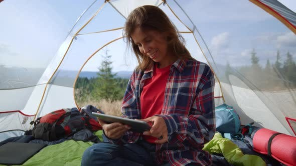 Woman Browsing Internet on Tablet