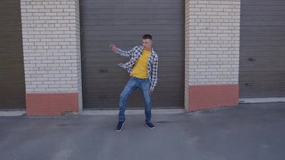 Fast Moves of Young Man Who Dancing