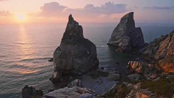 Thumbnail for View of Hidden Praia Da Ursa - Ursa Beach, Sintra, Portugal. Two Huge Rocks Raisng in Evening
