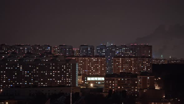 Thumbnail for Timelapse of Window Lights and Smoking Pipes in City at Night. Moscow, Russia
