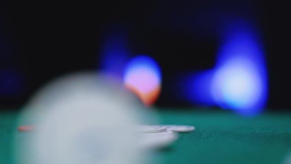 Casino Poker Chips Are Falling on Green Felt Background