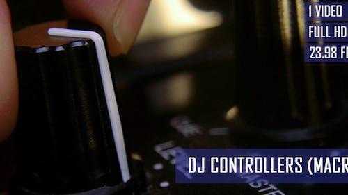 DJ Adjusting Mixer Controllers At Nightclub