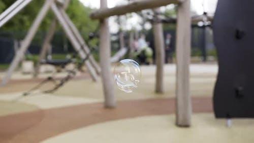 Soap bubbles flying slowly