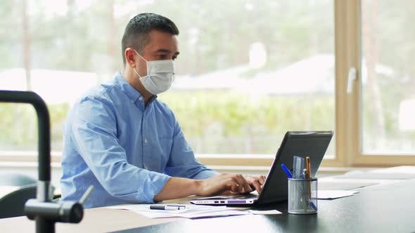 Thumbnail for Man in Mask with Laptop Working at Home Office