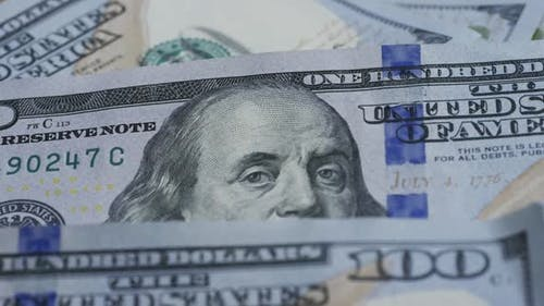 Rotating stock footage shot of $100 bills - MONEY 0130