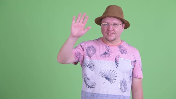 Thumbnail for Happy Overweight Bearded Tourist Man Waving Hand