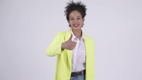 Thumbnail for Happy Young Beautiful African Businesswoman Giving Thumbs Up