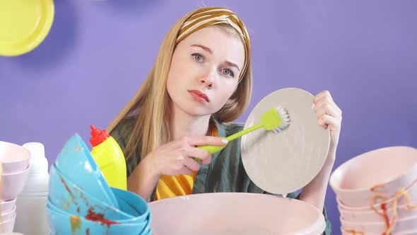 Thumbnail for Beautiful Housewife with Long Fair Hair Washing Dishes with a Brush