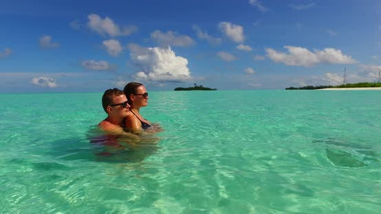 Thumbnail for Happy boy and girl married on vacation enjoy life on beach on sunny white sandy