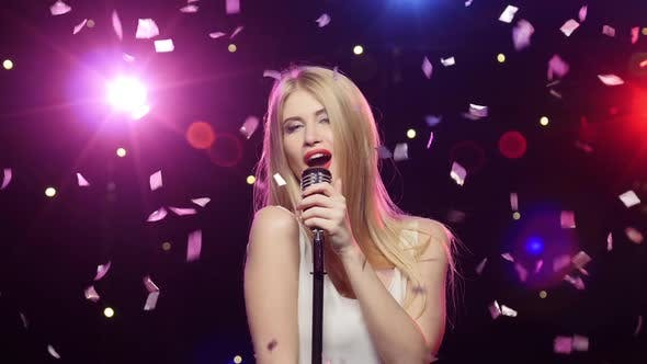 Thumbnail for Blonde Girl Singing Into a Retro Microphone Strobe Lighting Effect