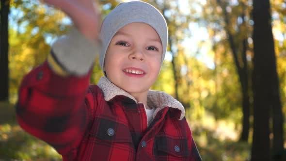 Thumbnail for Portrait Of A Happy Boy At The Autumn Park