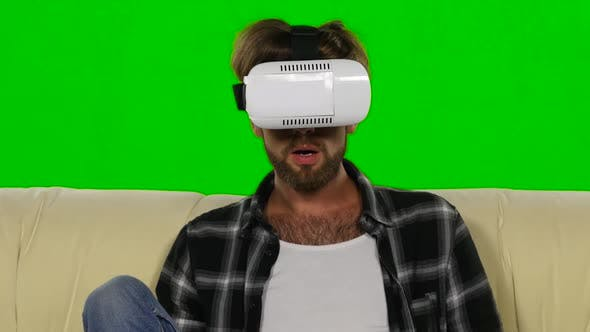 Thumbnail for Man Fascinated By the Movie in VR the Mask. Green Screen