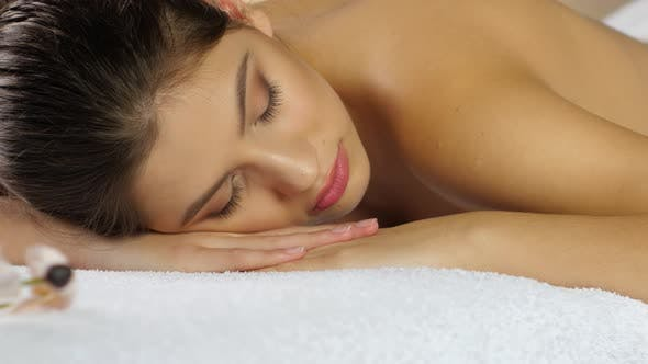 Thumbnail for Rest After Spa Treatments. Girl Sleeps on the White Towels
