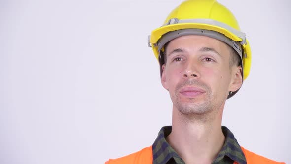 Thumbnail for Studio Shot of Happy Man Construction Worker Thinking
