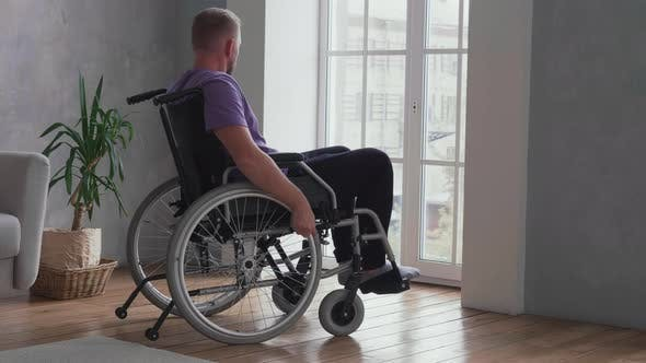 Thumbnail for Man sitting in wheelchair at home