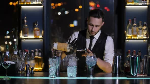 Thumbnail for Barman Pouring Liquor From Bottle in Jigger at Bar