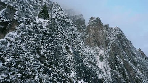 Aerial view of jagged mountains covered in snow
