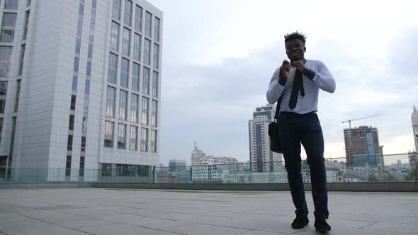 Thumbnail for Serious Businessman Taking a Break and Dancing