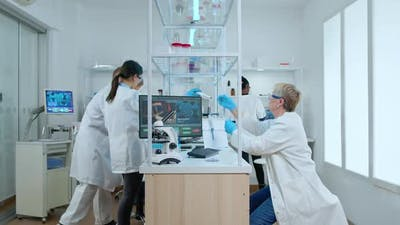 Multiethnic Team Working in Busy Laboratory