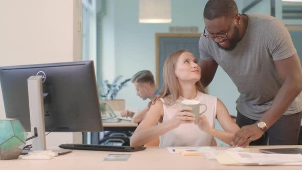 Thumbnail for African Guy Bringing Coffee To Girl at Co-working