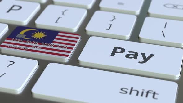 Thumbnail for Bank Card Featuring Flag of Malaysia As a Key on Keyboard