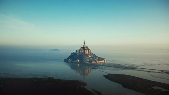 Thumbnail for Drone Flying Towards Epic Sunrise Mont Saint Michel, Famous Island Fortress Castle Surrounded